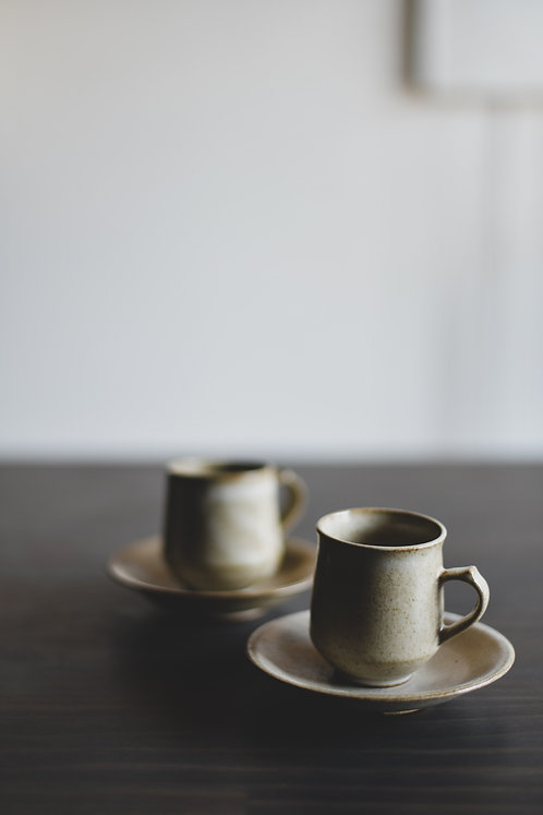 Ivory cups and saucers (a pair)