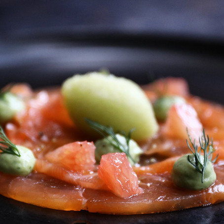Lemon and lime cured salmon, avocado and coriander puree, gin, tonic and lime sorbet