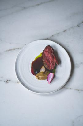Herdwick lamb, aubergine and cumin, black garlic, mint oil, lamb jus