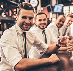 Handsome%20businessmen%20are%20drinking%2C%20looking%20at%20camera%20and%20smiling%20while