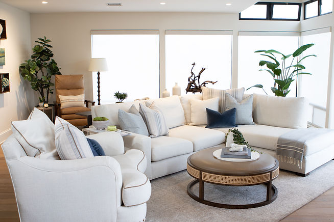 This coastal condo underwent a complete transformation. We created an open layout perfect for capturing the views of the sailboats and waves.  Loads of creamy whites, blues and textures were used to create  a relaxed mood throughout the home.