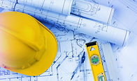 Construction plans with hardhat and level
