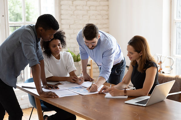 Employees review benefits paperwork