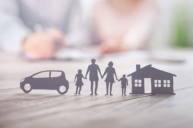 Paper cutouts of family with car and home
