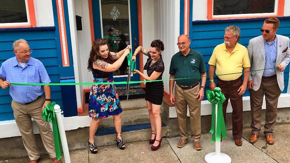 Ribbon Cutting! Pictured: Main Street Manager Bob Yoder, Aryn, Amber, the Mayor of Dayton Virgil Boruske, Councilman Bill Burns, and Assistant Mayor Ben Baker.