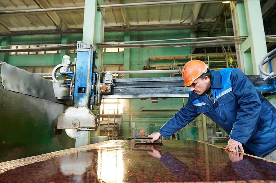 industrial worker at factory on granite