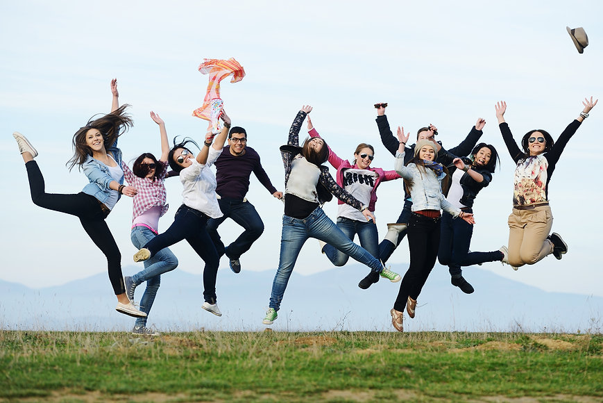 Happy teen girls having good fun time outdoors jumping up in air.jpg