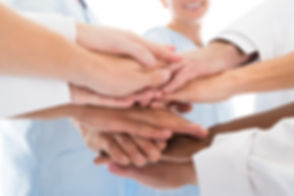 Medical Team Stacking Hands.jpg
