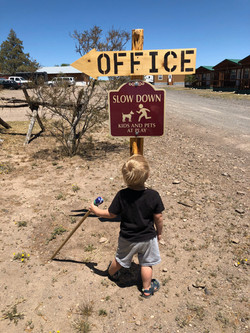 Boy at Office Sign