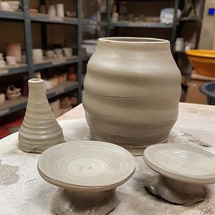 Parts of a thrown teapot, spout, body, lids.