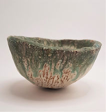 small trinket bowl with blue green glaze and texture.