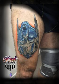 tatouage en couleur Transformers à Bordeaux