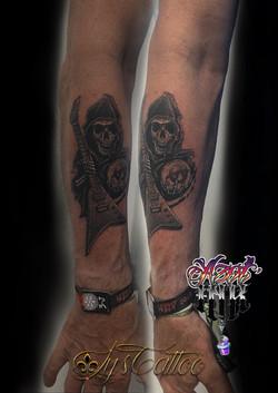 tatouage représentation de la faux à Bordeaux