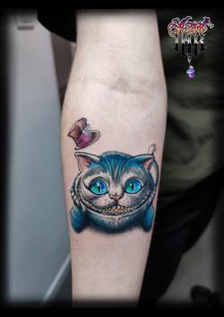 tatouage chat cheshire à Bordeaux