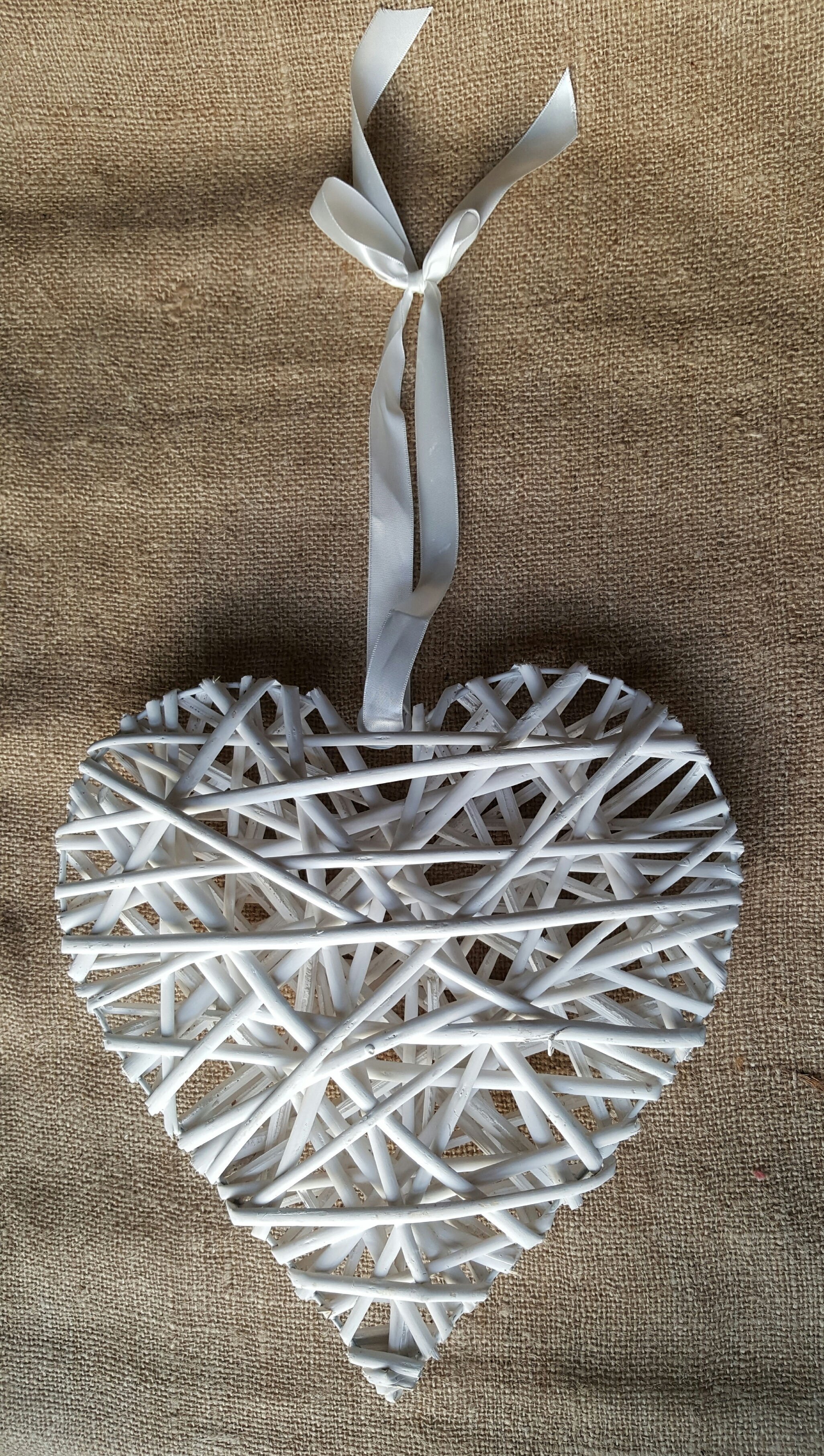 Hollow wicker heart with wooden