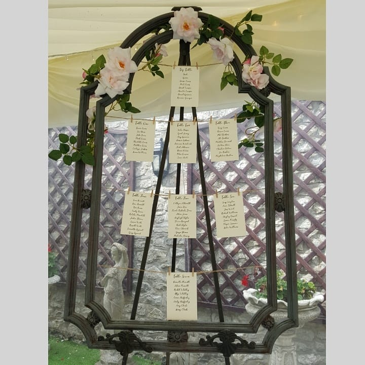 Faux metal frame with faux flowers