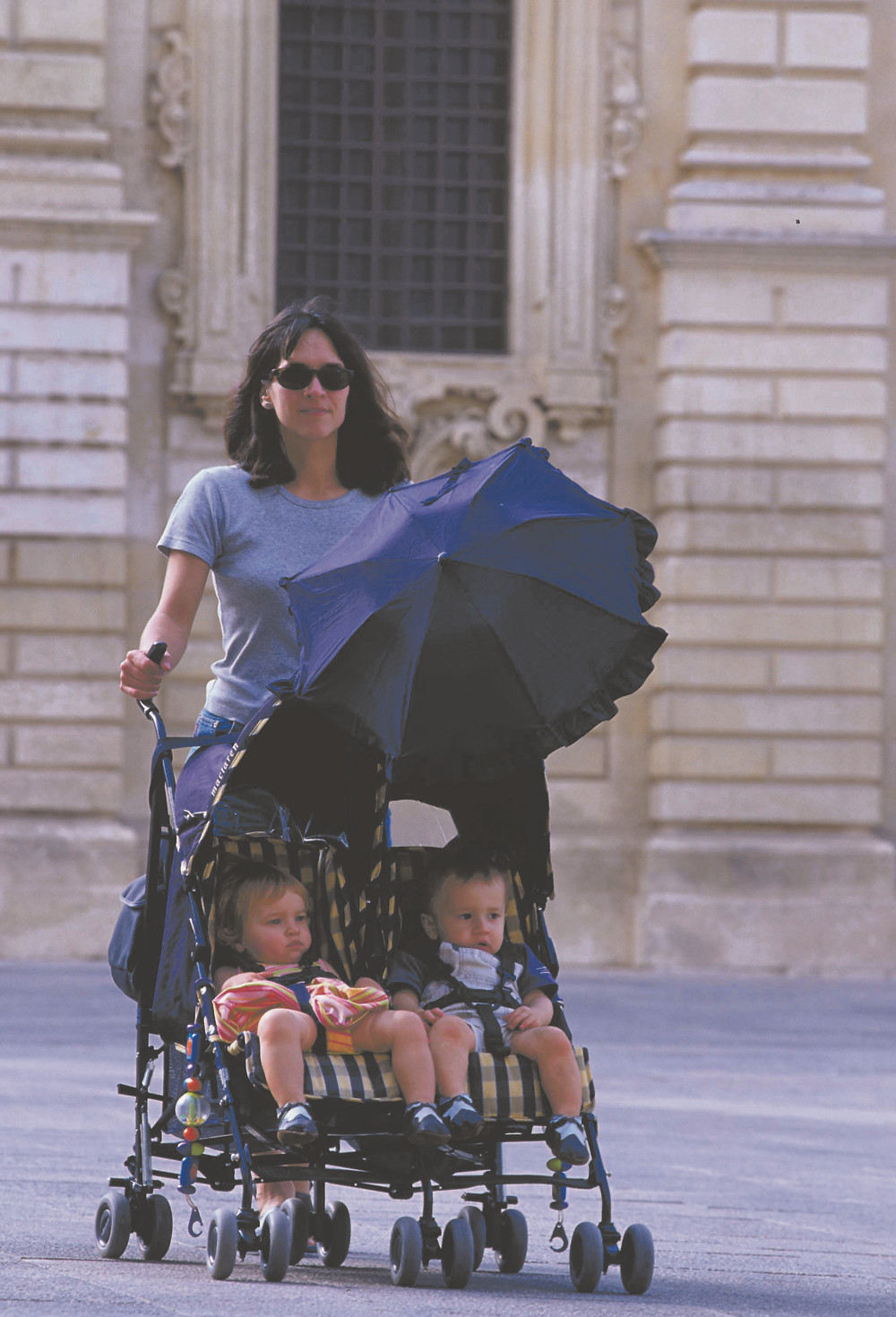 Pushing a double buggy around a piazza in Italy