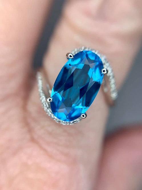 long oval blue topaz ring