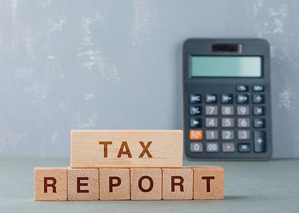 tax-report-concept-with-wooden-blocks-with-words-it-side-view.jpg