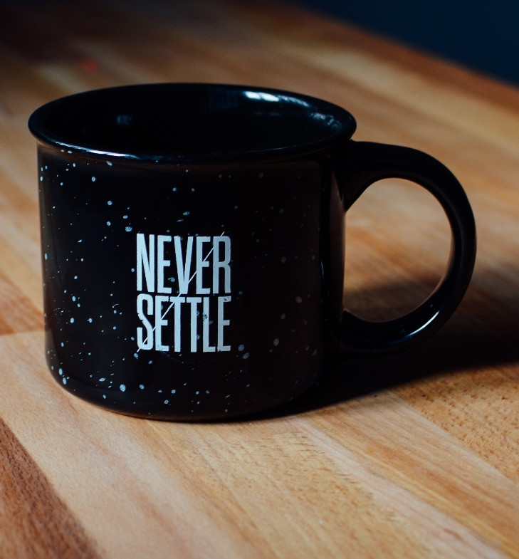 'Never Settle' Photo by Ryan Riggins on Unsplash