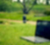 laptop-notebook-grass-meadow.jpg