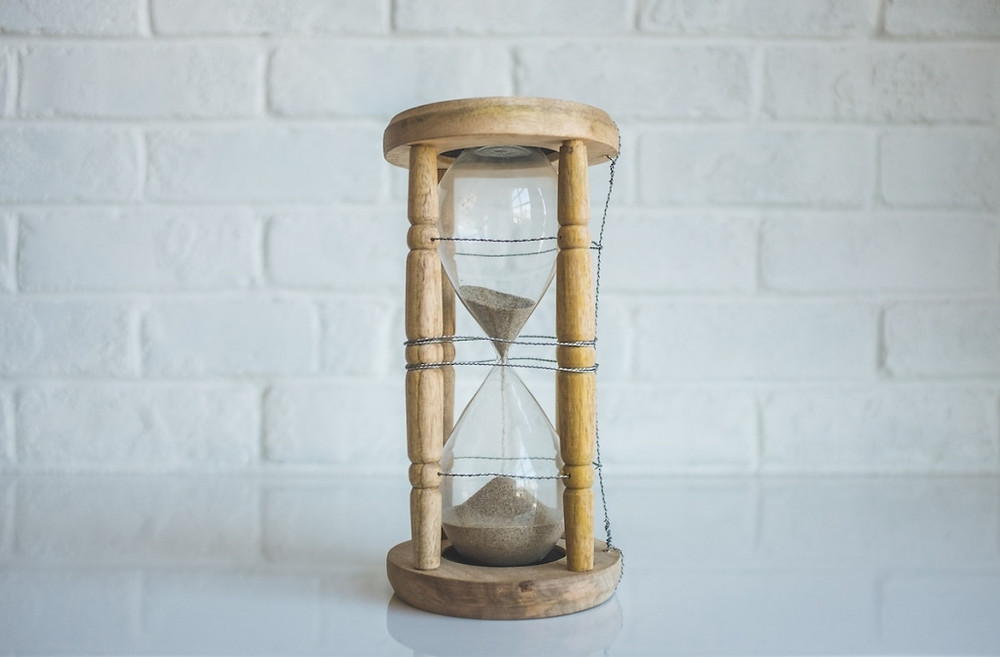 Picture of an hourglass on a table