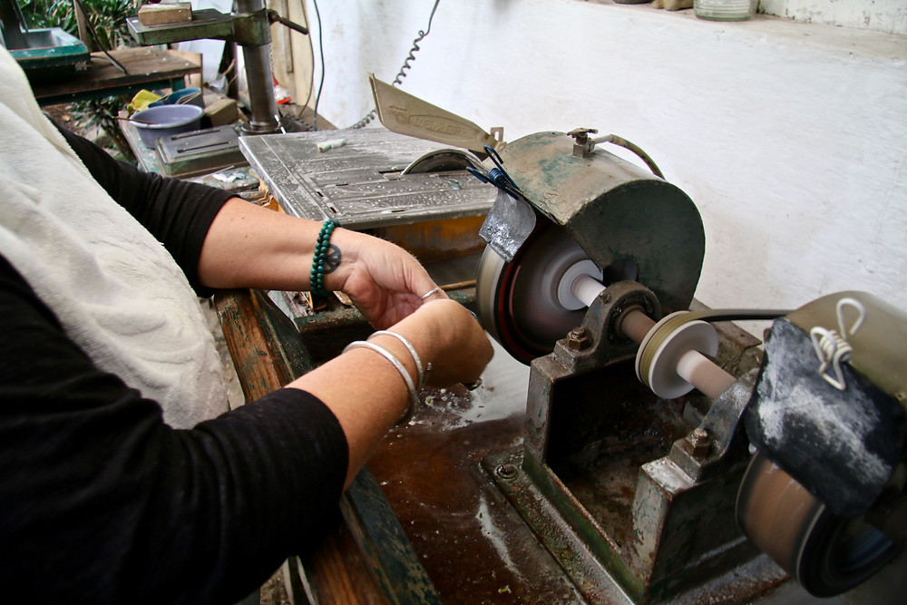 Grinding down the cut piece to get rid of rough edges and formalise the shape before endless polishing begins.
