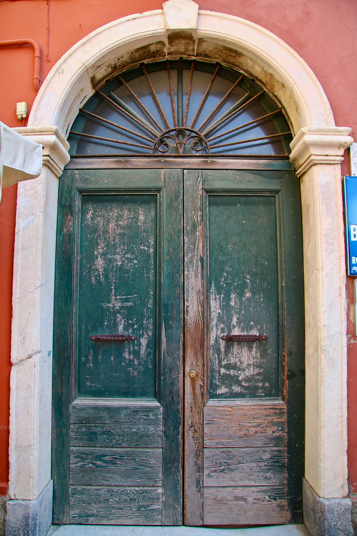 Weathered old green door.