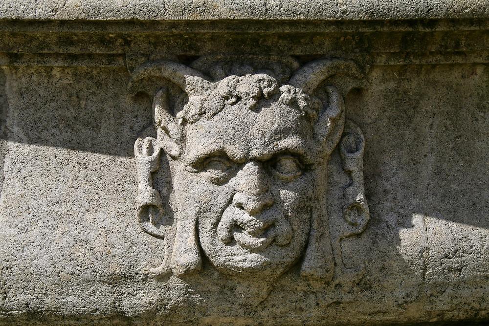 Horned faces on Bratislava's fountain.