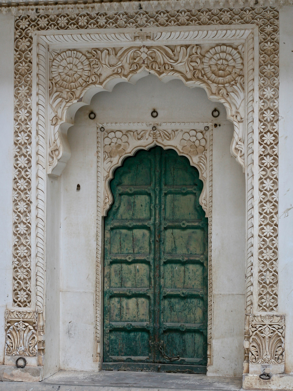 Where my obsession began, with a scalloped green door surrounded by white carved marble in India.