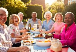 Portrait Of Senior Friends Enjoying Outd