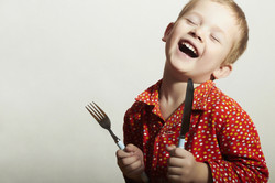 Funny Little Handsome Boy with Fork and