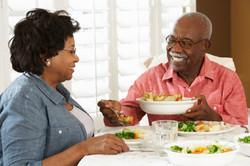 Senior Couple Enjoying Meal At Home