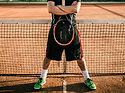 Tennis-Spieler auf Sandplatz