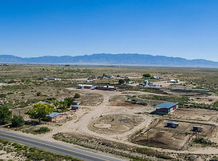 Proerty for Sale with Adobe Home, Covered Sheds, Workshop and Barn in rurul location in Belen, New Mexico listed with Nino Trujillo and Company by Christopher Trujillo.