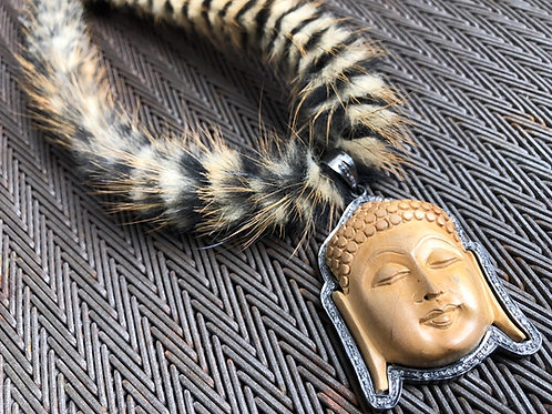 Buddha with diamonds and fur necklace
