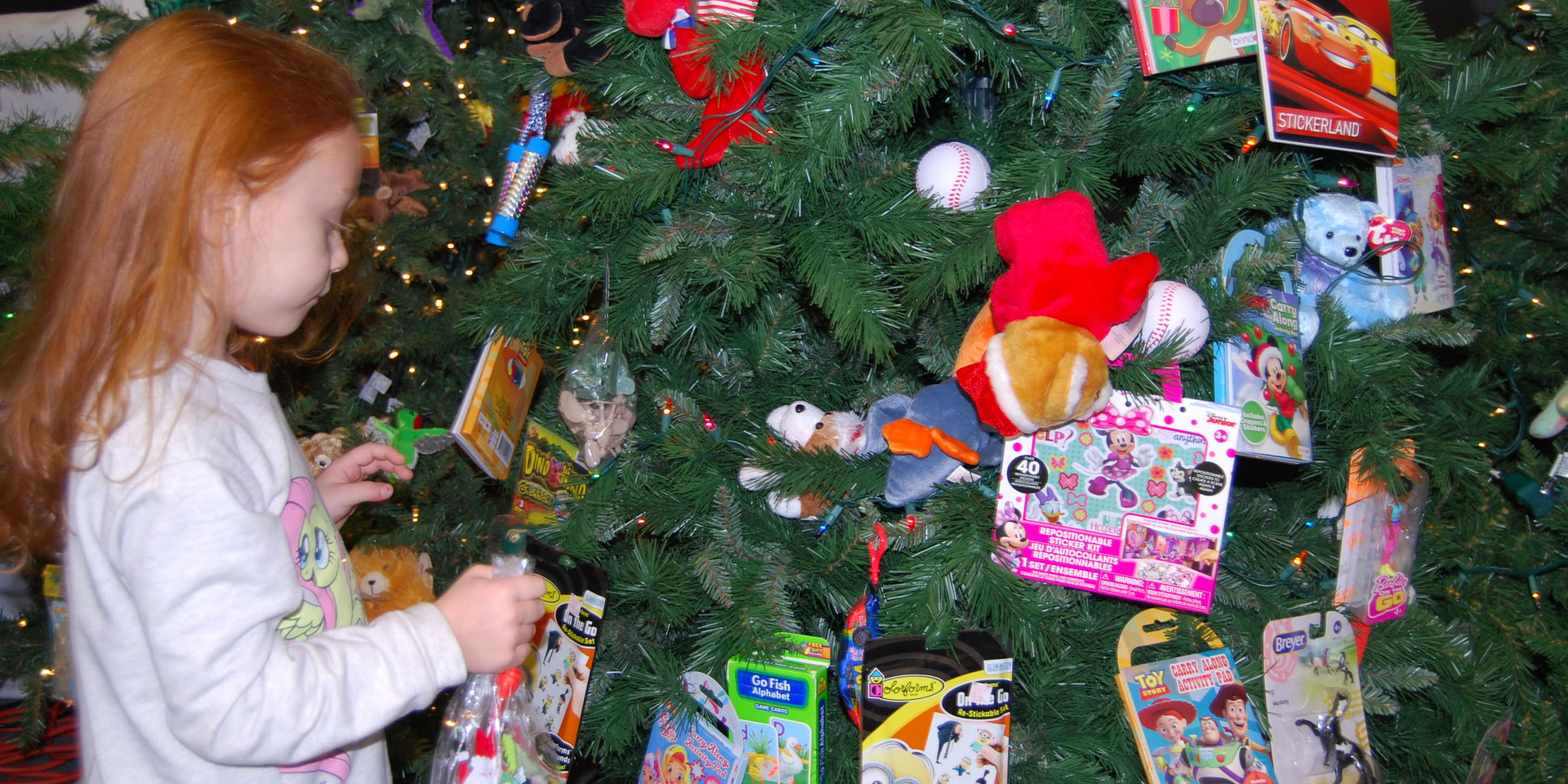 Picking gifts from the tree.