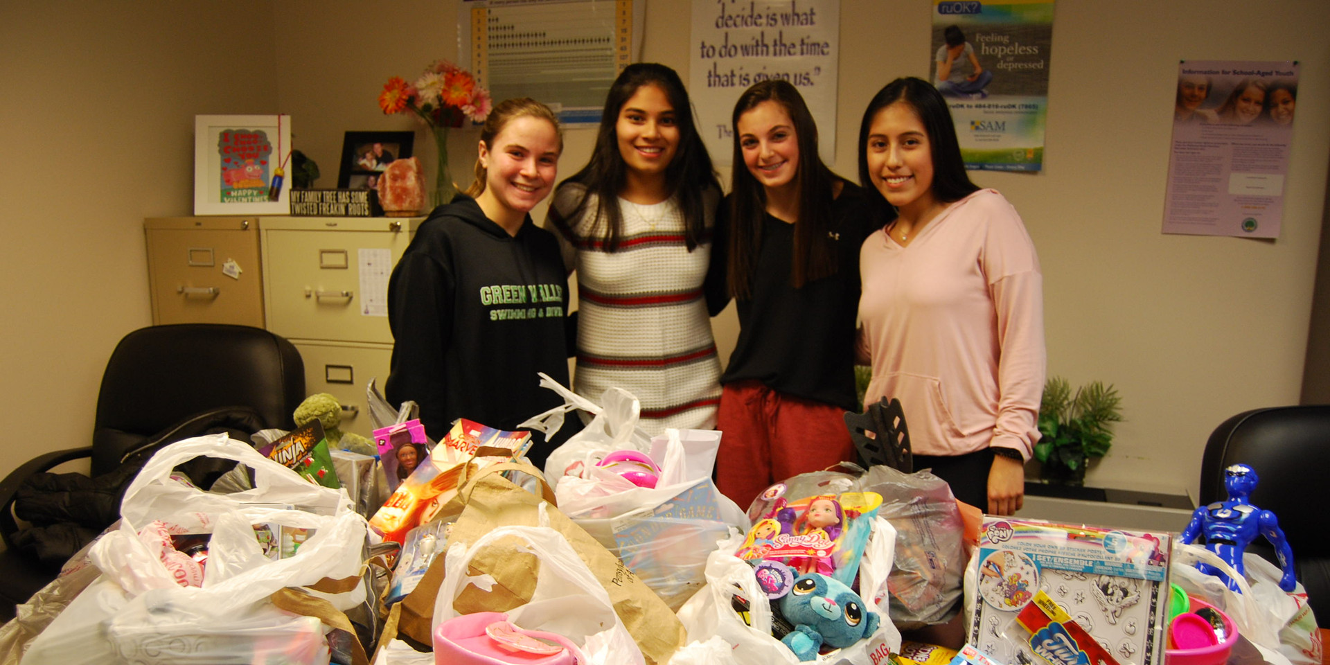 Wilson High School Ambassadors coordinated a toy drive to collect small toys for under the trees.
