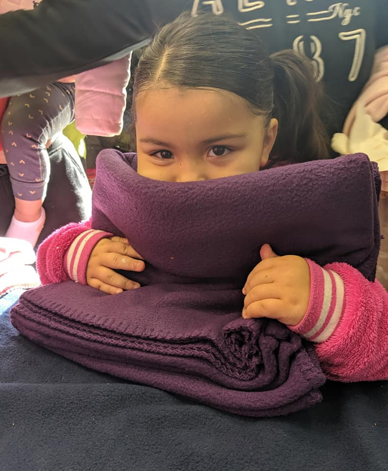 Snuggling with her new blanket from Blankets of Hope-Berks!