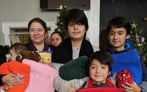 One family with their blankets from Blankets of Hope-Berks!