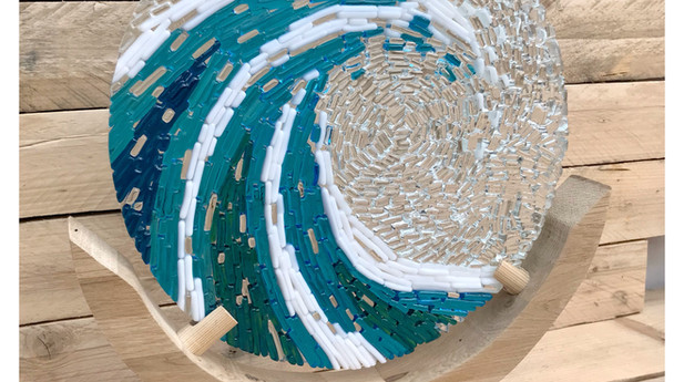 Breaking wave circle sculpture with stand