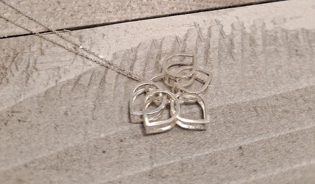 Caroline Draper - Lotus mini flower pendant