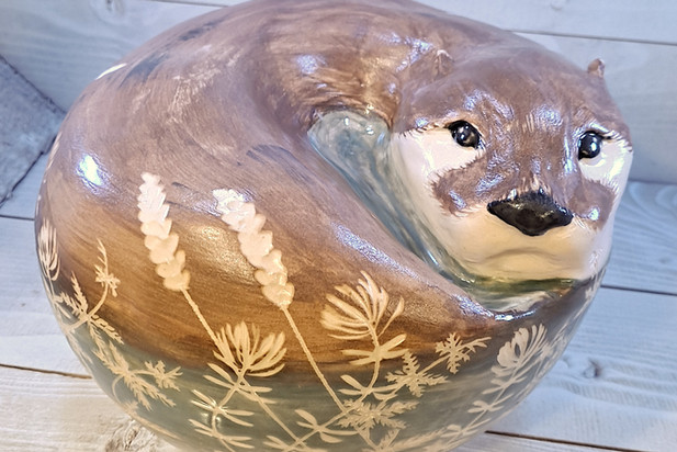 Otter Sculpture with Botanical Carvings