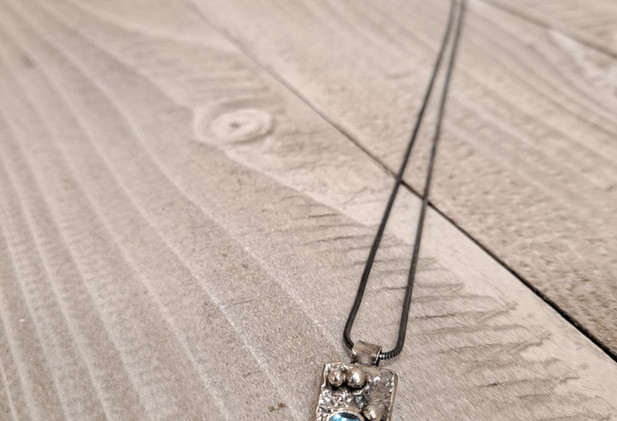 Sally Ratcliffe - Small rectangle pendant clouded pool swiss topaz