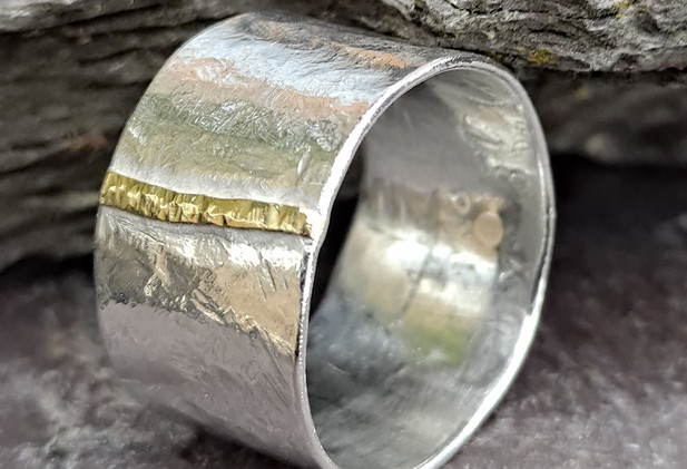 Wide band silver ring with 18ct gold pebble line