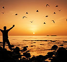 bigstock-Man-feeling-freedom-on-beach-d-