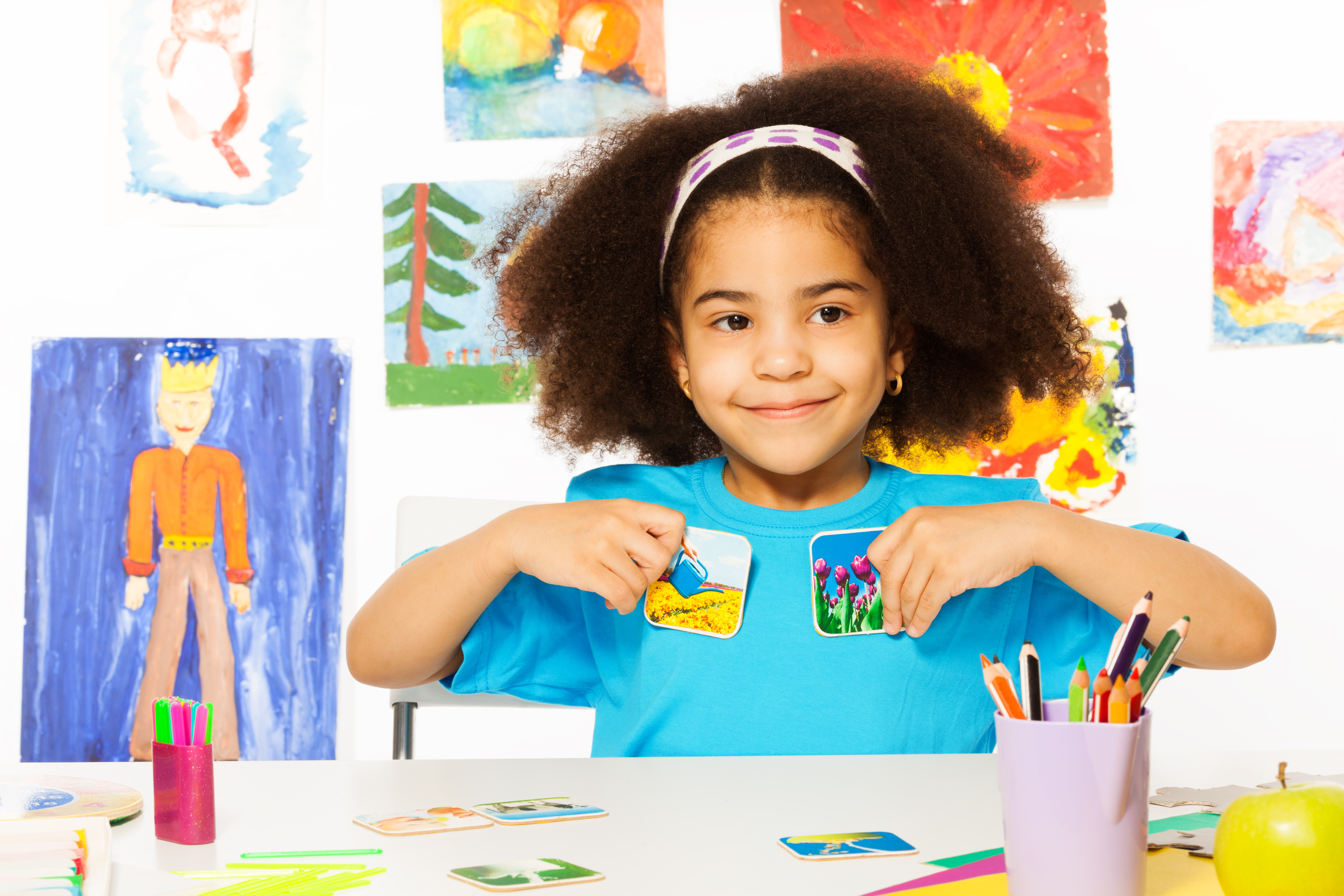 Image of child sitting at a desk