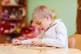 Child at a desk working on a puzzle