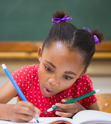Child in a classroom writing