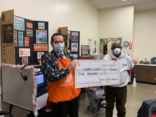 OLI Receives Check From Home Depot